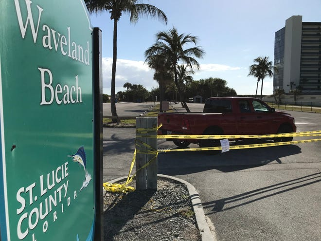 St. Lucie County plans to reopen its beaches, with restrictions outlined at Monday's news conference. St. Lucie beaches were closed last month, as shown in this March 23, 2020 photo. In this photo, Waveland Beach parking lot was closed off with yellow tape.