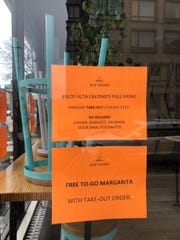 """Alta Calidad, a Mexican restaurant, closed its restaurant interior due to COVID-19 restrictions, but offers a """"Free To-Go Margarita"""" to patrons with their order in Brooklyn, New York, on March 20, 2020. New York City is adjusting to life during incremental restrictions due to the COVID-19 coronavirus outbreak worldwide."""