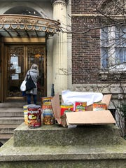 Canned food is left outside for donation during the COVID-19 pandemic in Brooklyn, New York, on March 20, 2020. Many residents have stocked up on nonperishables because of fears of becoming housebound. New Yorkers are adjusting to life during incremental restrictions due to the COVID-19 coronavirus outbreak worldwide.