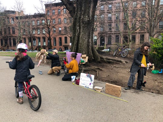 Puppeteers put on a play for passersby with a tape measure reminding people to stay at least 6 feet away in Fort Greene Park in Fort Greene, Brooklyn, New York, on March 18, 2020. The scene was seen during an hourlong walk by the photographer.