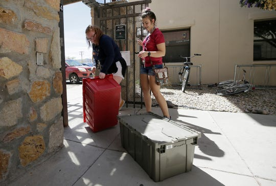 UTEP students Rae McCartney, left, a freshman political science major, and Samantha Miller, a junior kinesiology major, move out of Miner Village to head home to New Mexico on Monday. UTEP is closing dorms and giving students until the end of the week to move due to COVID-19 concerns
