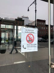 """A sign on an apartment building reads, """"No Deliveries Inside Building Please Wait Outside,"""" in Brooklyn, New York, on March 20, 2020. New Yorkers are adjusting to life during incremental restrictions due to the COVID-19 coronavirus outbreak worldwide."""
