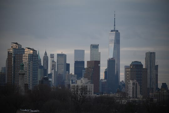 A view of downtown New York is seen from the roof of an apartment building in Clinton Hill, Brooklyn, New York, on March 17, 2020. Rooftops offer some relief from the stress of the coronavirus pandemic, despite being a no-go zone under New York state restrictions.