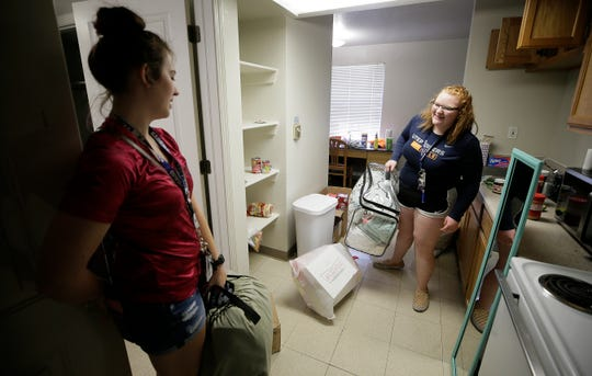 UTEP students Rae McCartney, right, a freshman political science student and Samantha Miller,  a junior kinesiology student, move out of Miner Village to head home to New Mexico Monday. UTEP closed their dorms and are giving students until the end of the week to move out due to COVID-19 concerns.