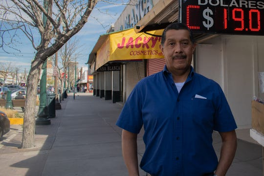 Joe Hernandez, business owner stands on now a deserted street in downtown El Paso, area know for its busy commerce activity.