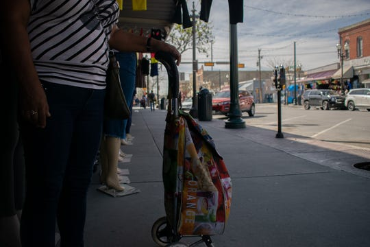 Guadalupe Ortega, 55, holds a shopping car as she shops at the stores in downtown El Paso