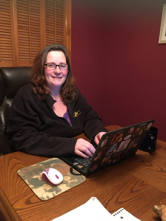 Writer Lisa Iannucci working at her Poughkeepsie kitchen table though she's also been known to work from home in bed, in her recliner and even in the backyard.