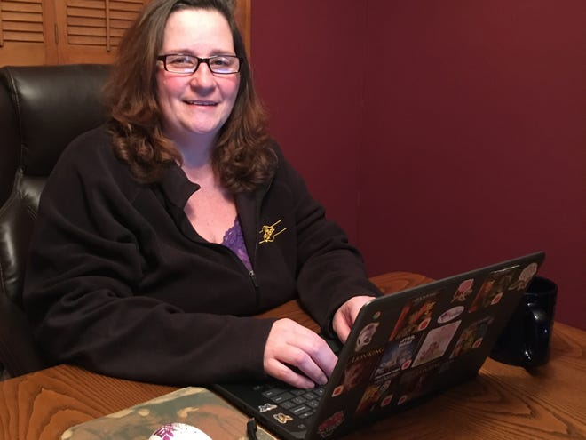 Writer Lisa Iannucci working at her kitchen table, though she's also been known to work from home in bed, in her recliner and even in the backyard.