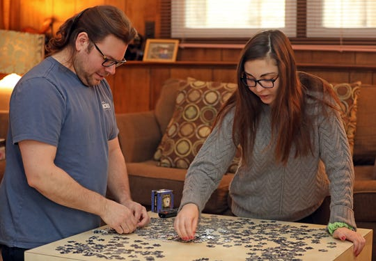 Kelsey DiCarlo and her boyfriend Michael Mancuso keep themselves busy by working on a puzzle during the coronavirus quarantine in Thiells March 20, 2020.