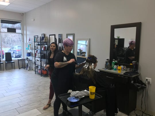 Michelle Miller of Stephanie K Salon styles one of her last heads before business was shut down by coronavirus concerns.