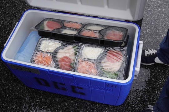 Freshly prepared meals wait inside a cooler for deliver to seniors in need of food assistance.