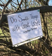 """An inspirational message found in Glasgow Park over the weekend. This is a paraphrase of what Mother Teresa said. He actual quote was: """"We cannot all do great things. But we can do small things with great love."""""""