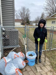 Another yard with six bags of doodoo and proud Eli beholds a job well done.