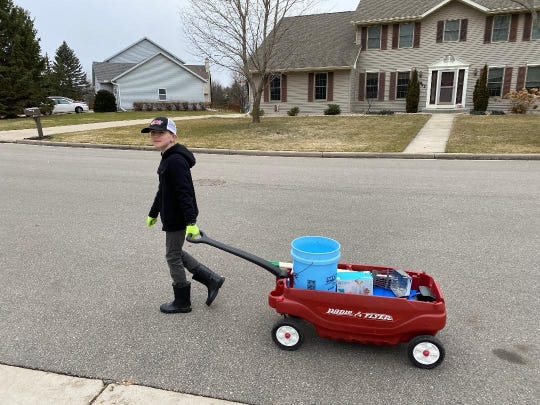 His Radio Flyer wagon filled with the tools of his trade, Eli heads off to work.