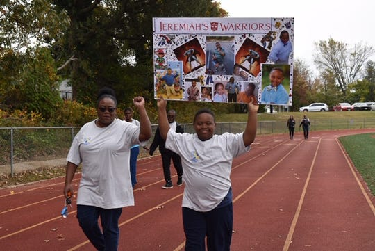 """Opal Foster and her 12-year-old son, Jeremiah, participated last fall in the Prince George's County Parents of Down syndrome """"Angel Walk,'' which aims to raise awareness. Foster was recently laid off because of the coronavirus outbreak."""