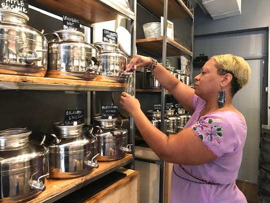 Lynette Jefferies helped out at The Spice Suite in Washington, D.C. , March 20, 2020. The store is temporarily closing because of the coronavirus