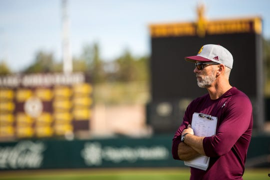ASU coach Tracy Smith watches his team warm up.