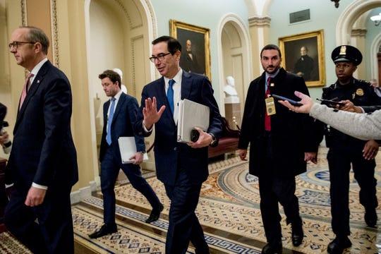 Treasury Secretary Steven Mnuchin, third from left, and White House Legislative Affairs Director Eric Ueland, left, walk to a meeting with Senate Minority Leader Sen. Chuck Schumer on Monday.