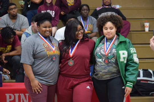 Natchitoches Central's Sharissa Johnson (left), Pineville's Brionna Ford and Peabody's Kai Kirk were the top three finishers for the 220-plus class at the LHSAA Central Region meet Feb. 28.