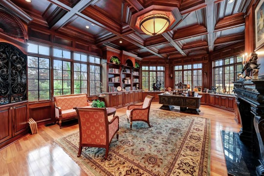 The study offers an abundance of natural light and coffered ceilings
