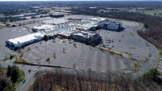 Few cars are shown in the Freehold Raceway Mall parking lot in Freehold Township shortly after 10am Tuesday, March 24, 2020.
