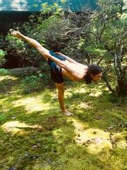 Justin Marx, a New Jersey-based shaman, practicing yoga outdoors.