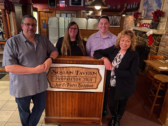 Joe and Patti Bossone (front) are the owners of Squan Tavern in Manasquan.  Their daughter, Meredith, and son, Nicholas, help run the restaurant.