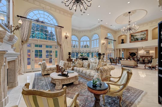 The great room offers floor to ceiling custom windows.