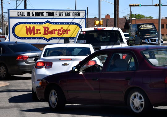 Cars line up during lunchtime at Mr. Burger at Buffalo Gap and Antilley roads for the drive-through line Tuesday March 24, 2020.