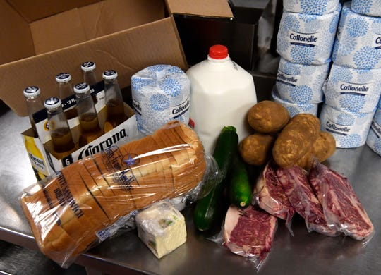 "A ""Quarantine Kit"" from Copper Creek Tuesday March 24, 2020. The kit, which starts at $78, includes a gallon of milk, two rolls of toilet paper, a six-pack of beer, a loaf of bread, half a pound of butter, two zucchinis, four potatoes and four ribeye steaks."
