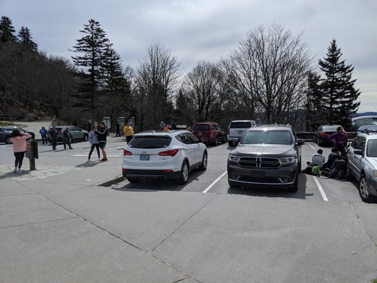 People pack into the Newfound Gap Parking Area March 22, in Great Smoky Mountains National Park. Following COVID-19 guidelines by the CDV, that park is closed through April 6.