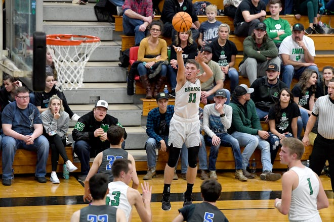 Mountain Heritage's Nathaniel Ledford goes up for a shot against Madison during their game at Mountain Heritage High School on Jan. 17, 2020.