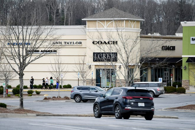 People walked at the Asheville Outlets March 19, 2020.