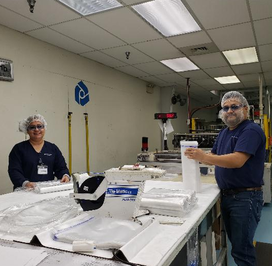 Employees at Printpack Medical in Marshall prepare a shipment of medical packaging.
