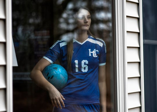 Indiana State bound senior Maddie Alexander from Harper Creek poses for a portrait on Tuesday, March 24, 2020 at her home in Battle Creek, Mich. As Michigan works to slow the spread of COVID-19, Alexander waits to play her final season of high school soccer.