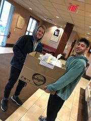 Students picked up their dinners at the Binghamton University Chabad Center. Shabbat 2020 was held virtually due to the coronavirus pandemic on Friday, March 20, 2020. Photo provided by Rabbi Levi Slonim