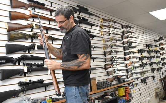 Dennis Russo, who co-owns Affordable Pawn & Gun at 1801 Post Road, in Melbourne with his wife, Yvette, has seen gun sales greatly increasing in since the start of COVID-19 precautions, and the grocery and supply hoarding began.