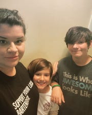 Jillian Jeffery, with children Zella and Isaac, is manager of The Wine Cellar at Amici's in Suntree.