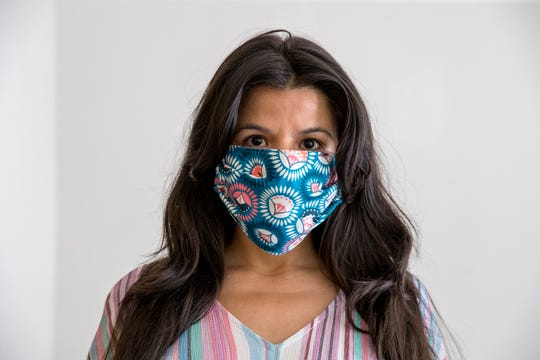 Monica Briones makes masks for healthcare workers from her home on Monday, March 23, 2020. Immunocompromised she is unable to leave her apartment due to the risk of contracting the coronavirus.
