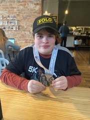 Trapper Leeth, 15, shows off his medal for participating in the 2019 Star Wars Rival Run Weekend.