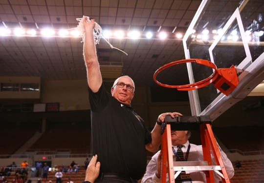 Salpointe Catholic head coach Jim Reynolds holds-up the net after defeating Peoria High to win the 4A Boys basketball championship at Veterans Memorial Coliseum on Feb. 29, 2020 in Phoenix, Ariz.