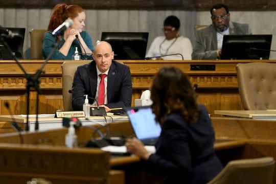 Cincinnati City Council member Greg Landsmann listens to Health Commissioner Melba Moore address council, Wednesday, March 18, 2020, at City Hall in Cincinnati.