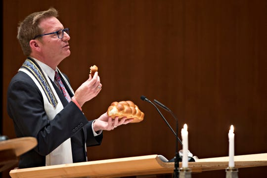 Rabbi Lewis Kamrass holds the weekly shabbat service through livestream from Isaac M. Wise Temple in Amberley, on Friday, March 20, 2020.