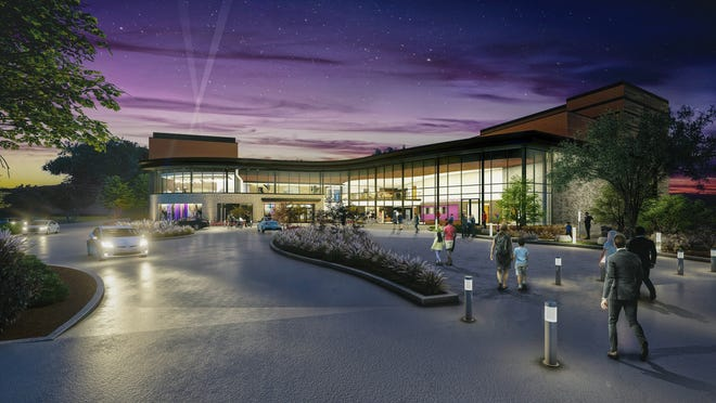 An artist's rendering of an evening view of the front of the Playhouse in the Park's new theater complex, scheduled to open in late 2022.