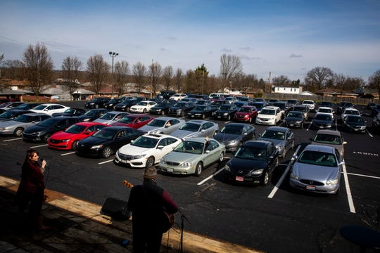 James Ledbetter and Tara Olson perform songs for about 100 vehicles at the drive-in church service at Lindenwald Baptist Church on Sunday, March 22, 2020 in Fairfield. The congregation turned their radio to 98.1 and could hear the service from their cars.