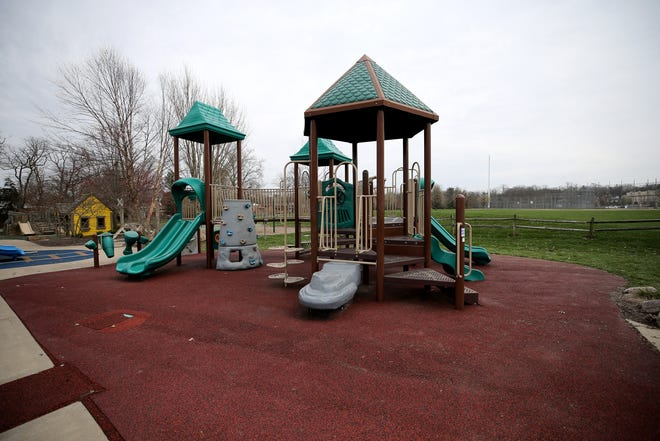 A playground sits empty at Beach Acres Park, Tuesday, March 24, 2020, in Anderson Township, Ohio. Tuesday was the first day of Ohio Gov. Mike DeWine's shelter-in-place order in response to the new coronavirus pandemic. As the weather gets warm and sunny, families are reminded to keep social distance measures in place to stop the spread of the virus.