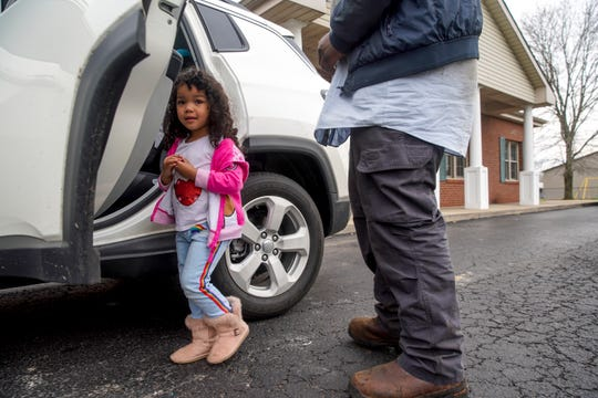 Symae Hill, 3, walks up to get in the car after being picked up by her dad Andre Hill, right, at Golden Apple Preschool in Clarksville, Tenn., on Monday, March 23, 2020.