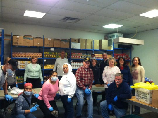 The Perth Amboy St. Vincent dePaul food pantry volunteers distributed supplemental groceries Saturday, March 21, to needy food pantry clients.