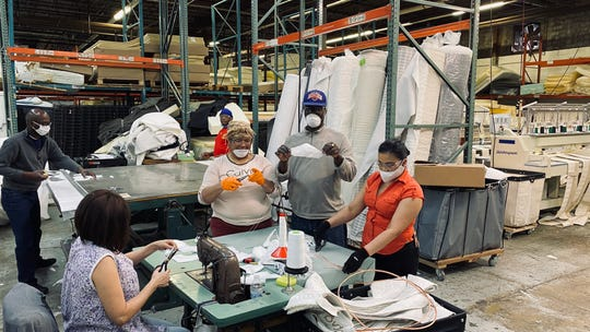 Employees at Eclipse International's mattress factory in North Brunswick making protective face masks to be donated to healthcare professionals during the coronavirus pandemic.