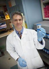Dr. David Alland